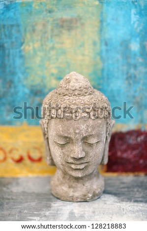 Stone Buddha head sculpture photographed in studio. - stock photo