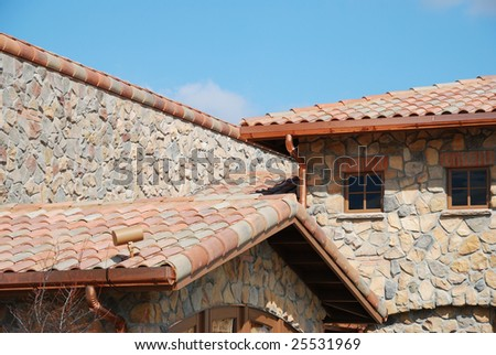 stone building exterior with beautiful roof - stock photo