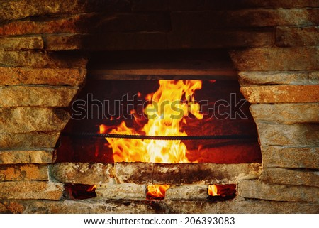 Stone burning stove background. Warm and cosy fire.  - stock photo