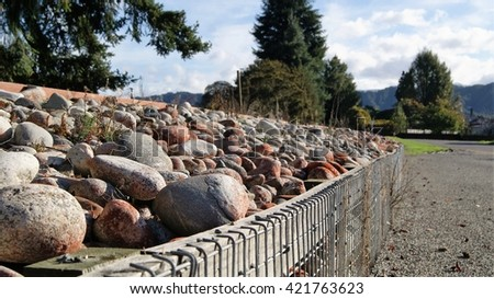 Stone caged wall - stock photo
