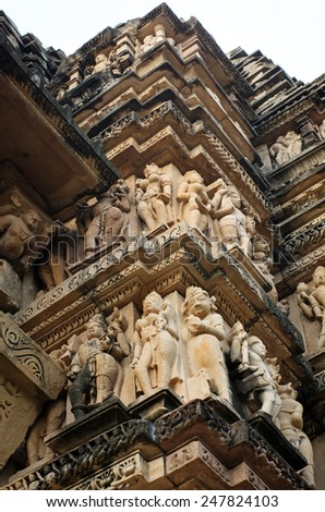 Stone carved erotic bas relief in Hindu temple in Khajuraho, India. Unesco World Heritage Site Stone carved erotic bas relief in Hindu temple in Khajuraho, India. Unesco World Heritage Site  - stock photo