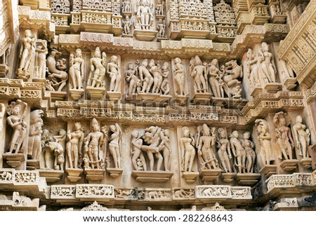 Stone carved erotic sculptures in Hindu temple in Khajuraho, Madhya Pradesh, India - stock photo