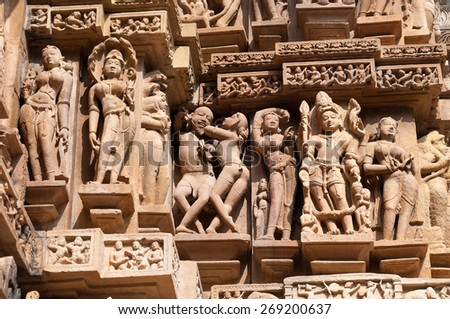 Stone carved erotic sculptures on Lakshmana temple. Western temples of Khajuraho. Madhya Pradesh. India. Built around 999 - stock photo