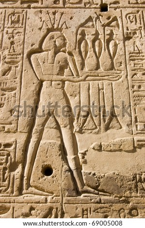 Stone carving of the Ancient Egyptian god of the River Nile Hapi.  Shown wearing a crown of lotus flowers.  Wall of the Temple of Seti I, West Bank of the Nile, Luxor, Egypt. - stock photo