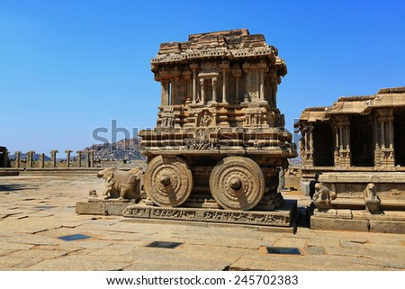 Stone chariot in courtyard of Vittala Temple at blue sky in Hampi, Karnataka, India - stock photo
