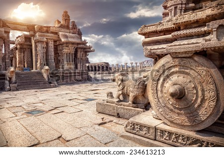 Stone chariot in courtyard of Vittala Temple at sunset overcast sky in Hampi, Karnataka, India - stock photo