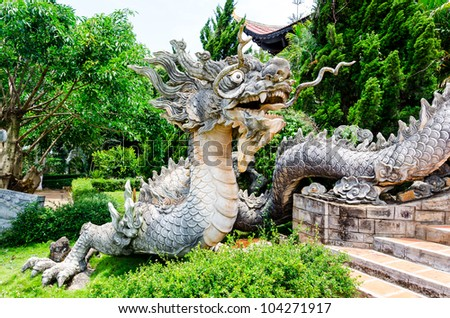 Stone Chinese Dragon Sculpture of The Chinese Temple in Vietnam - stock photo