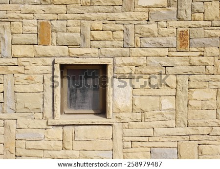 Stone cladding plates on the wall with window - stock photo