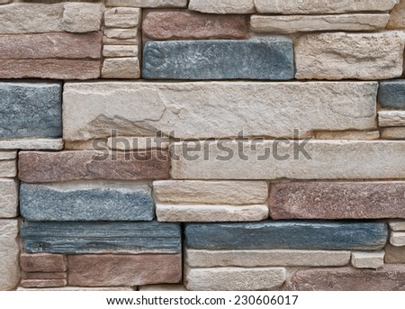 Stone cladding wall detail, background. - stock photo