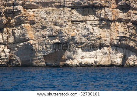 stone cliff viewed from se level - stock photo