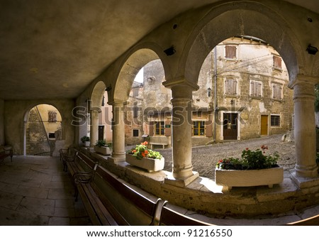Stone columns and interior of the medieval loggia in Groznjan - stock photo
