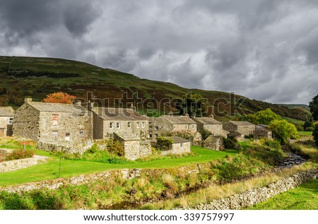 Stone cottages in Thwaite, England - stock photo