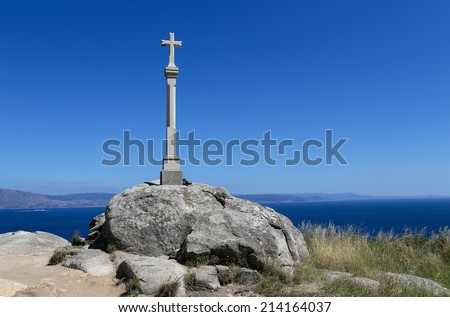 Stone cross at Cape Finisterre, final destination for pilgrims on the Way of St James. It is located at the Costa da Morte in Galicia. In Ancient Rome it was considered to be the end of the world. - stock photo