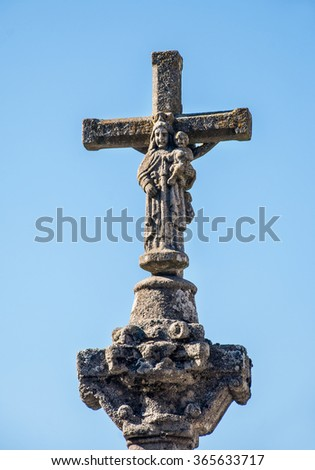 Stone cross with the Virgin and Child from middle age - stock photo