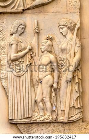 stone facade fresco decoration scenes from ancient Greek myths - stock photo