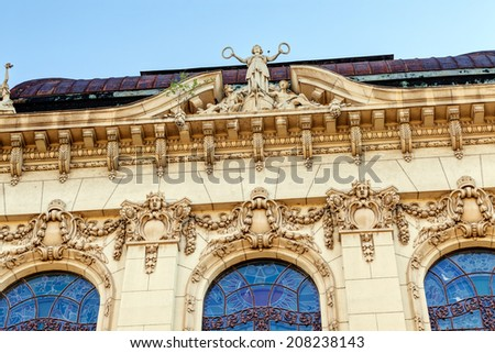 stone facade on classical building with ornaments and sculptures - stock photo