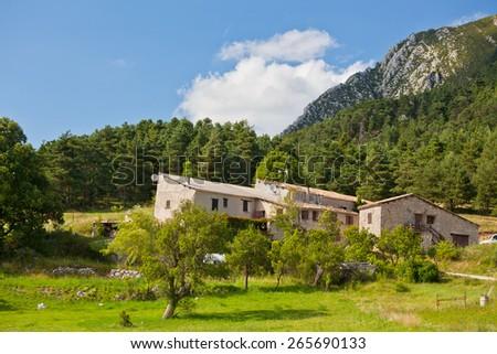 Stone farmhouse in Provence mountains, France. Horizontal shot - stock photo