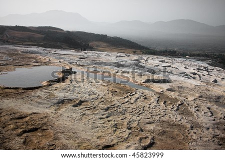 Stone field in the desert similar to moonscape - stock photo