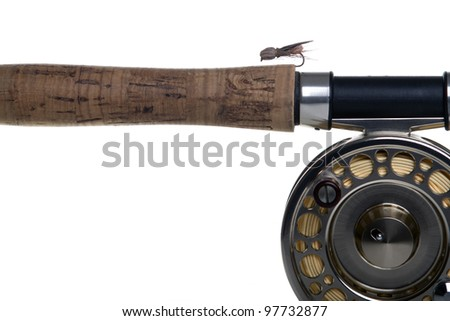 Stone fly dry fly on the rod with reel isolated on white close up - stock photo