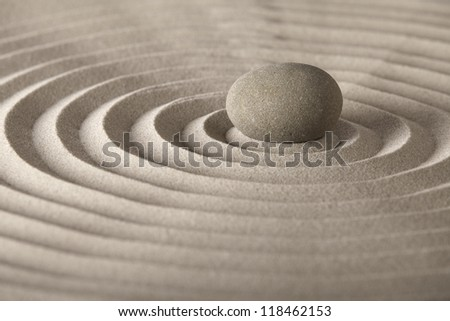 stone for spa relaxation or zen meditation concept for purity spirituality harmony and simplicity pattern in the sand - stock photo