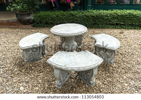 Stone Garden Table and four chairs. - stock photo