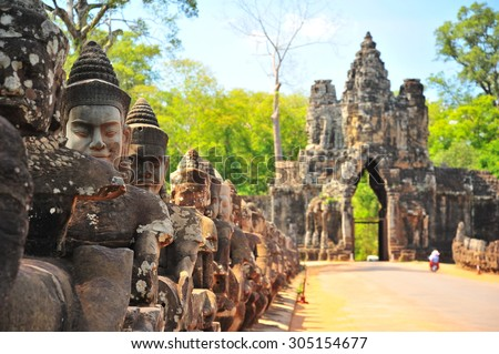 Stone Gate of Angkor Thom in Cambodia - stock photo