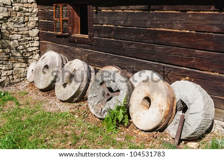 stone grinders round open-air museum in Czech - stock photo