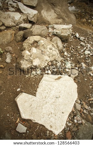 Stone Heart On The Ground - stock photo