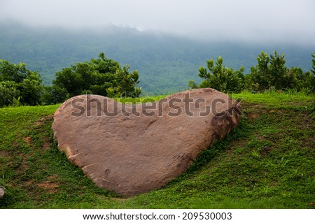 Stone in shape of heart - stock photo