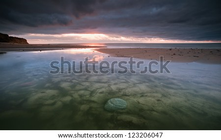 stone in the water - stock photo