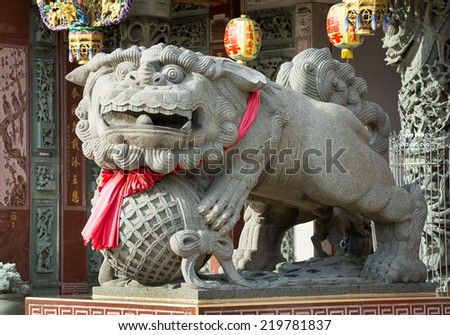 Stone Lion in Chinese temple. - stock photo