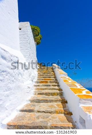 Stone made stairs on the road to Hozoviotissa Monastery in Amorgos island in Greece - stock photo