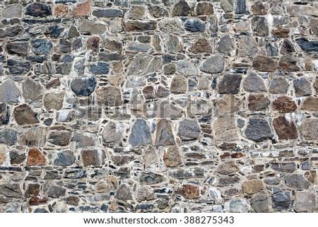 stone masonry wall pattern texture closeup - stock photo