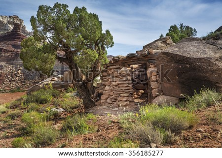 Stone miner cabin ruin at an abandoned radium mine from the 1880s in the San Rafael Swell in Utah near Temple Mountain. - stock photo