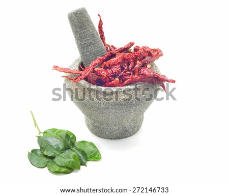 stone mortar and pestle with dry chillies  - stock photo