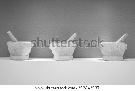 Stone mortars and pestles  - stock photo