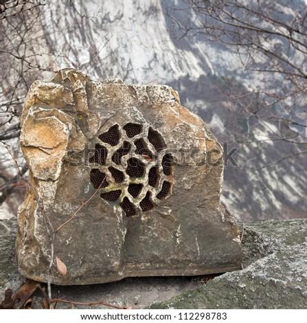 stone musical speaker in nature, mountain - stock photo