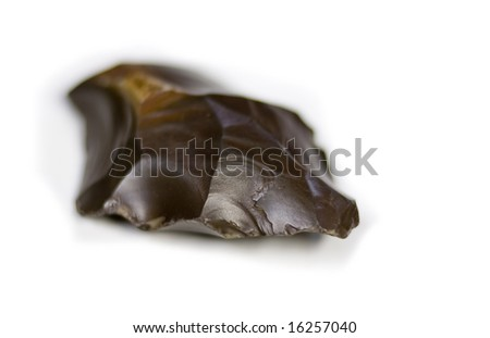 Stone / obsidian hand axe, an artifact from early man - stock photo
