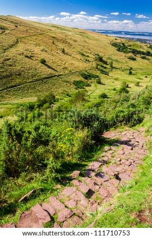 Stone path in the mountains - stock photo