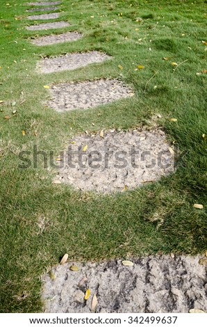 Stone path - Stone path in grass bed - stock photo