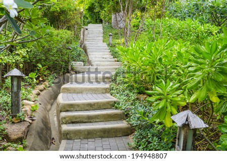 Stone path way on the lake of urban park. - stock photo