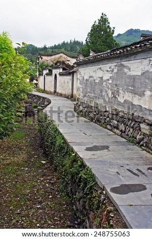 Stone pathway around the walls of xidi ancient village in Anhui province, China, - stock photo