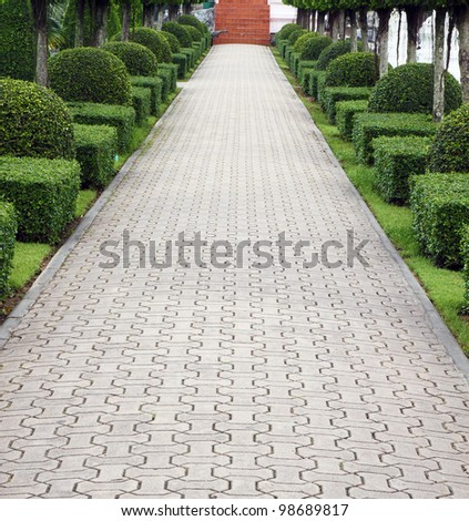 Stone pathway in garden - stock photo