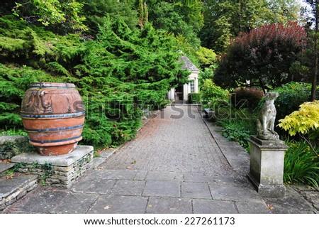 Stone Paved Path through a Beautiful Garden - stock photo