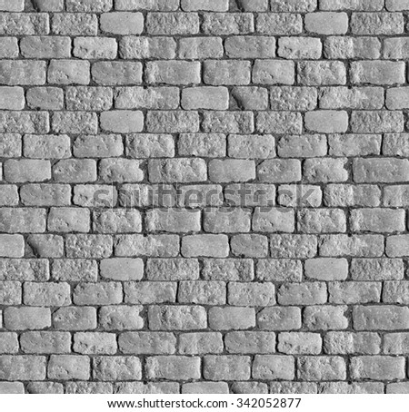 Stone pavement texture. Granite cobblestoned pavement background. Abstract background of old cobblestone pavement close-up. Perfect tiled and close up for all sides. - stock photo