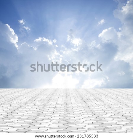 Stone paving and the cross with amazing light. - stock photo