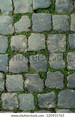 Stone paving texture shot in Rome, Italy - stock photo
