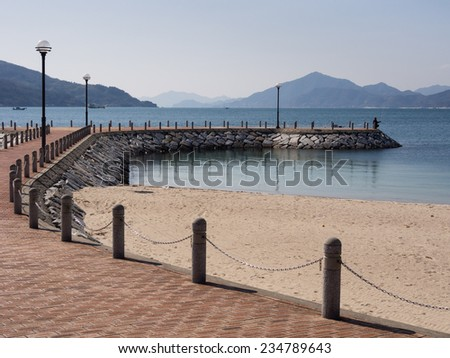 Stone pier in a beach park - stock photo