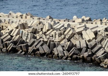 Stone Pier on the blue Atlantic Ocean Water - stock photo