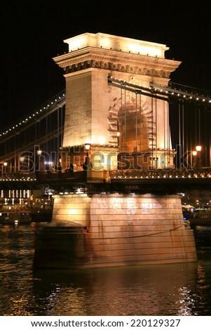 Stone pile of the Chain bridge illuminated by night, Budapest, Hungary - stock photo